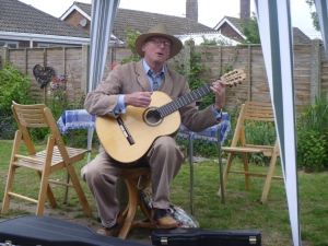 Mister P plays a Purnell guitar