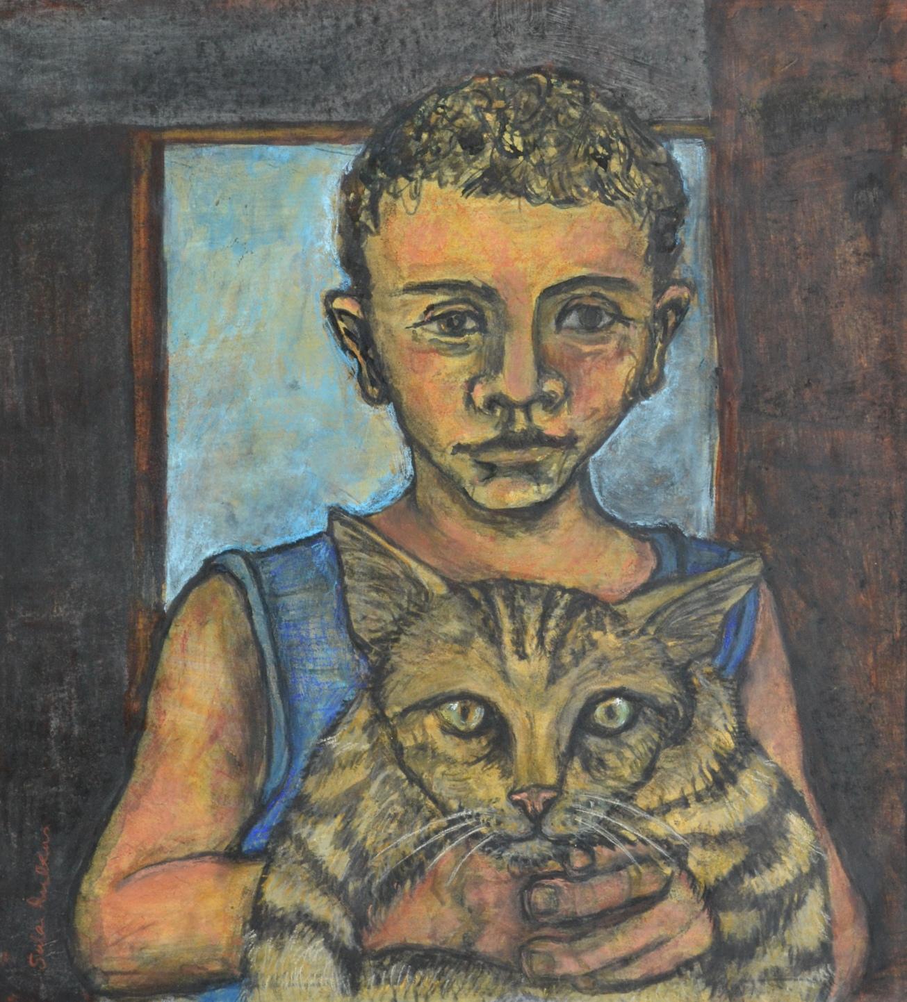 Fadi holding his Cat Aleppo
